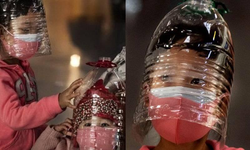 Пластиковая бутылка на голове от короновируса